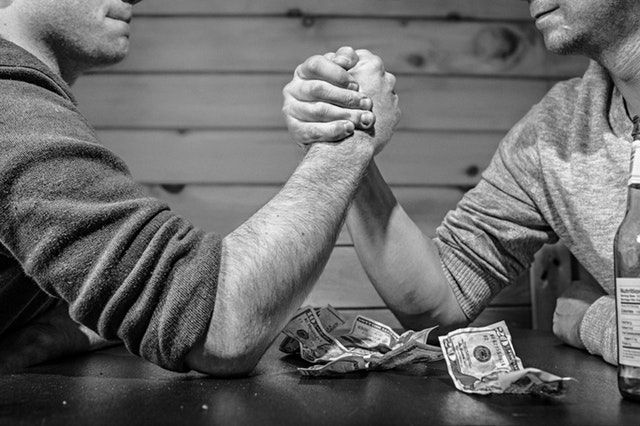 Sell House Fast We Buy Houses in Charleston South Carolina-two-guys-arm-wrestling